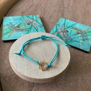 Jewelry - Adjustable bracelet with gold tone flower design